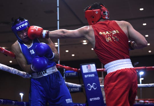 Reno's JJ Mariano, left, takes on Victor Aranda, of El Paso, during the USA Boxing 2019 Western Elite Qualifier and Regional Championships at the Grand Sierra Resort in Reno on March 29, 2019.