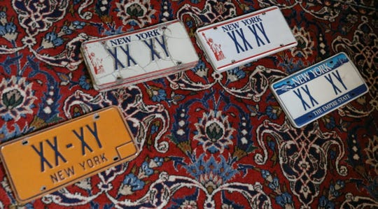 Custom plates owned by Victor Poleshuck that he has had on his cars for over thirty years, at his Pittsford home Thursday, March 28, 2019.