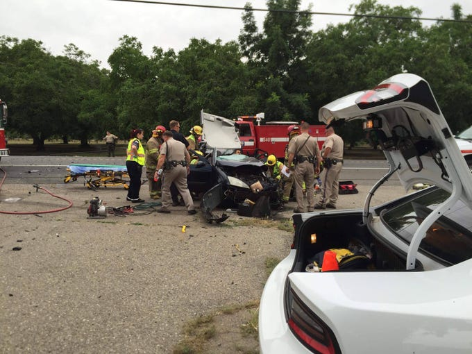 Emergency personnel tend to Dani Gonzalez and his car following the 2017 crash.