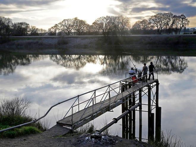 In this Feb. 23, 2016, file photo, fishermen try their luck along the Sacramento River in the San Joaquin-Sacramento River Delta, near Courtland.