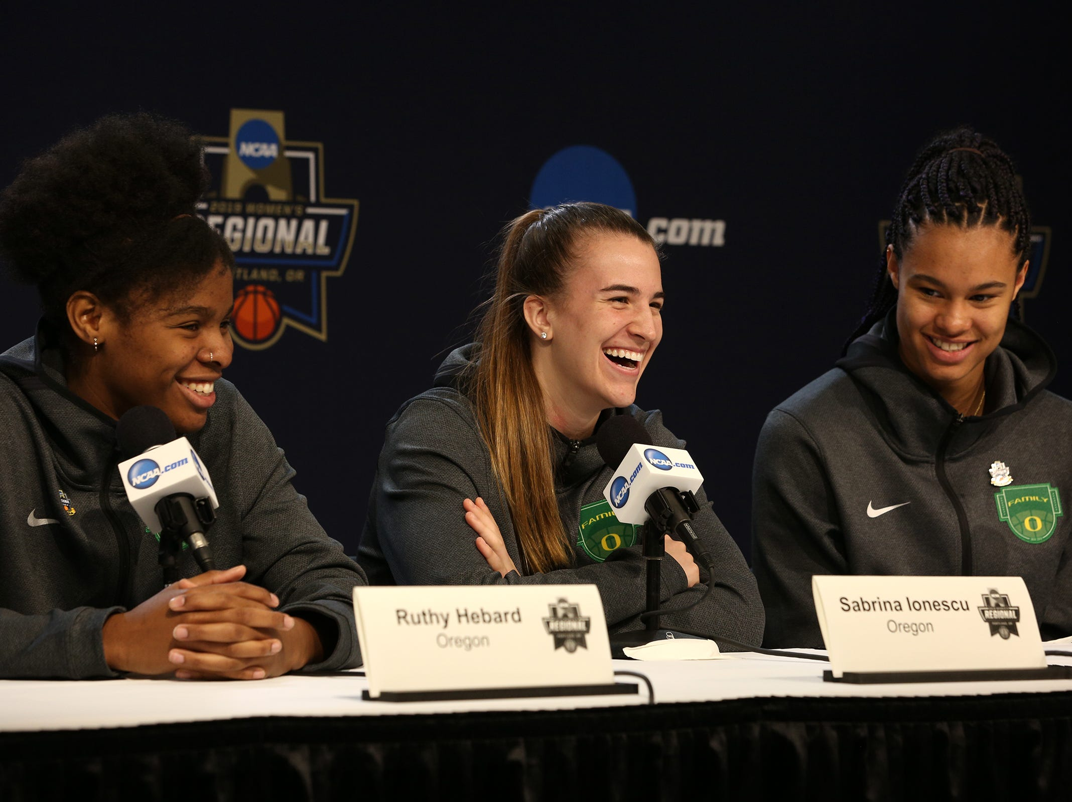 Oregon players Ruthy Hebard, Sabrina Ionescu and Satou Sabally answer questions during a press conference prior to the NCAA Women's Regional at the Moda Center in Portland on March 28, 2019.