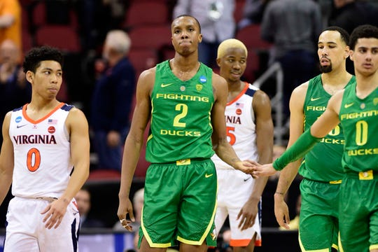 Mar 28, 2019; Louisville, KY, United States; Oregon Ducks forward Louis King (2) reacts during the second half in the semifinals of the south regional against the Virginia Cavaliers of the 2019 NCAA Tournament at KFC Yum Center. Mandatory Credit: Thomas J. Russo-USA TODAY Sports