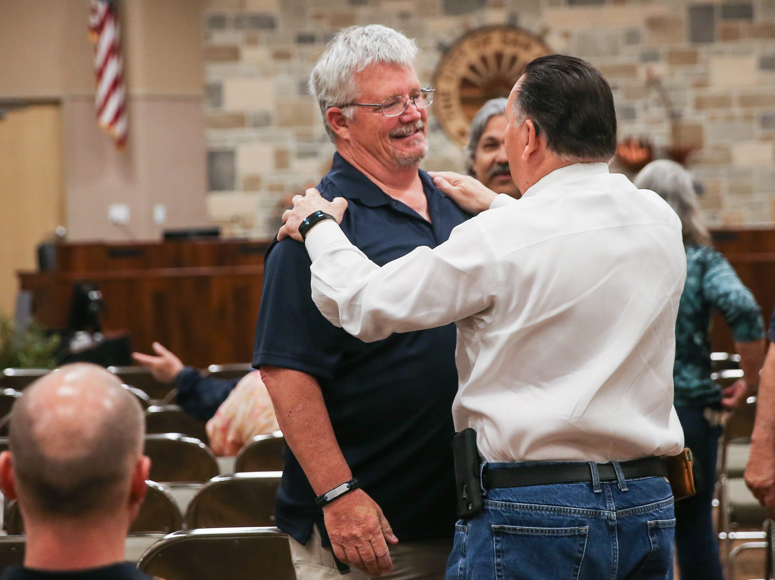 Harry Thomas, City of San Angelo council member, greets Officer Brian Bylsma before Bylsma's retirement ceremony Friday, March 29, 2019, at the McNease Convention Center.