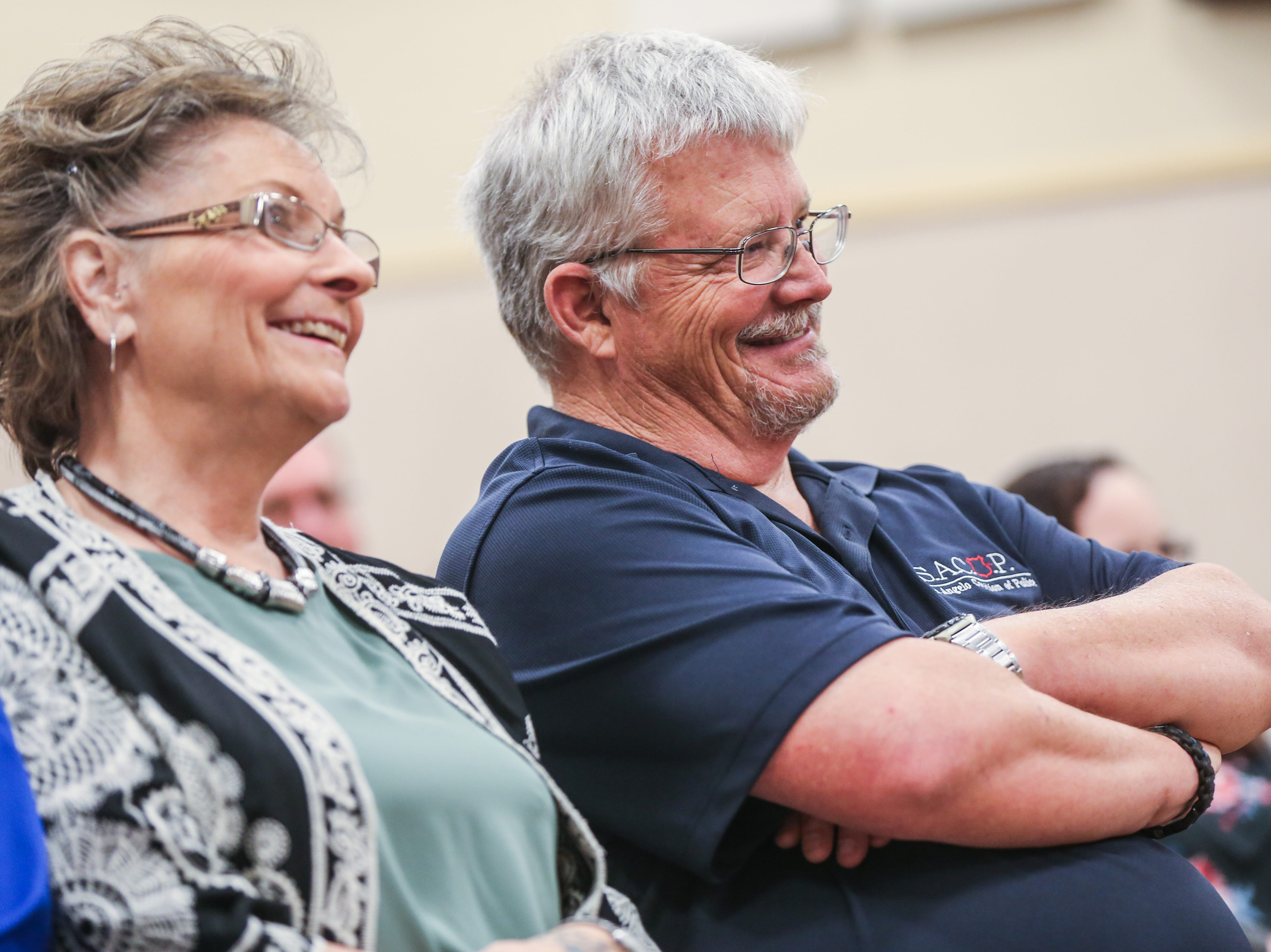 Officer Brian Bylsma and his wife, Kay, listen to Chief Frank Carter during the Bylsma's retirement ceremony Friday, March 29, 2019, at the McNease Convention Center.