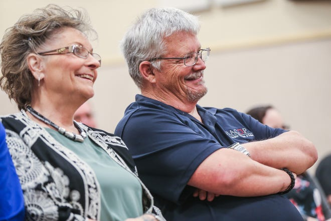 Officer Brian Bylsma and his wife, Kay, listen to Chief Frank Carter during Bylsma's retirement ceremony Friday, March 29, 2019, at the McNease Convention Center.