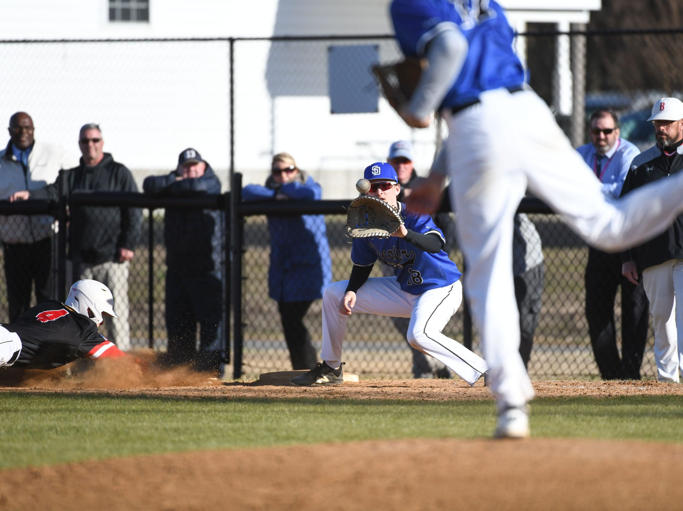 Stephen Decatur's Alex Gaddis with the pick off attempt  against Bennett on Thursday, March 28, 2019 in Salisbury, Md.