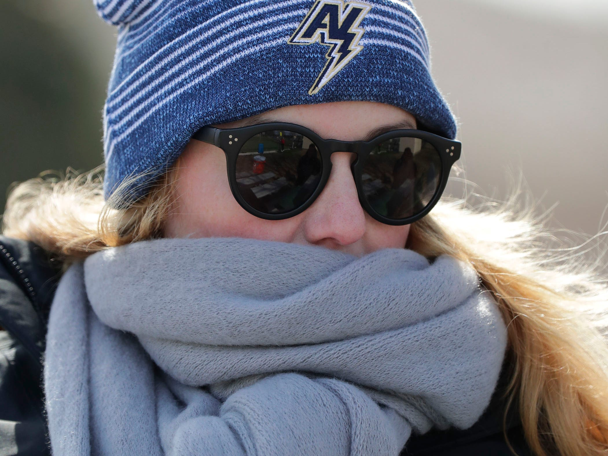 Petra Otto of Neenah, Wis. is well bundled at the Appleton North at Sheboygan North baseball game, Friday, March 29, 2019, at the Field of Dreams complex in Sheboygan, Wis.