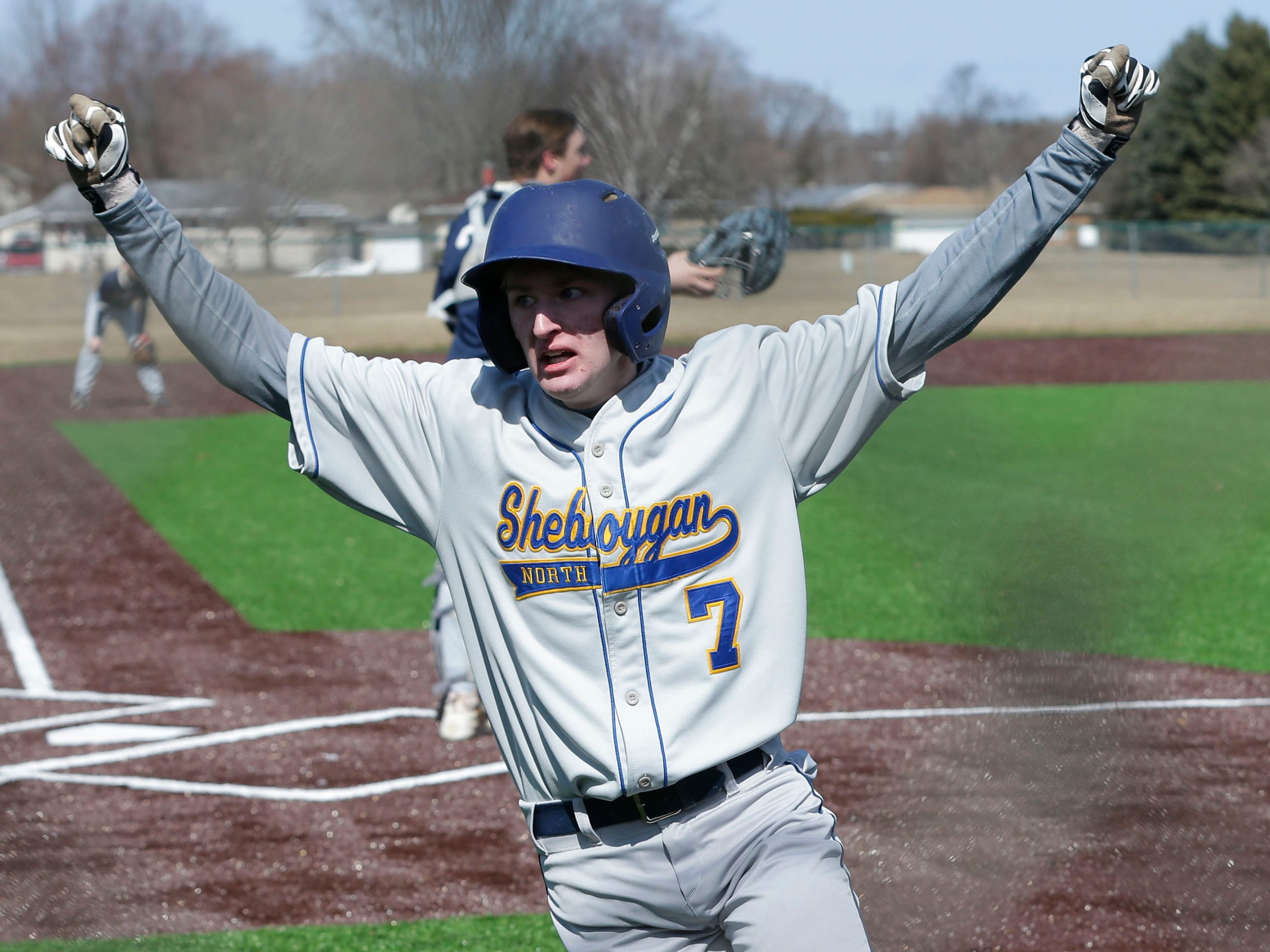 Sheboygan North's Brent Widder (7) reacts to making the game winning run against Appleton North, Friday, March 29, 2019, at the Field of Dreams complex in Sheboygan, Wis.