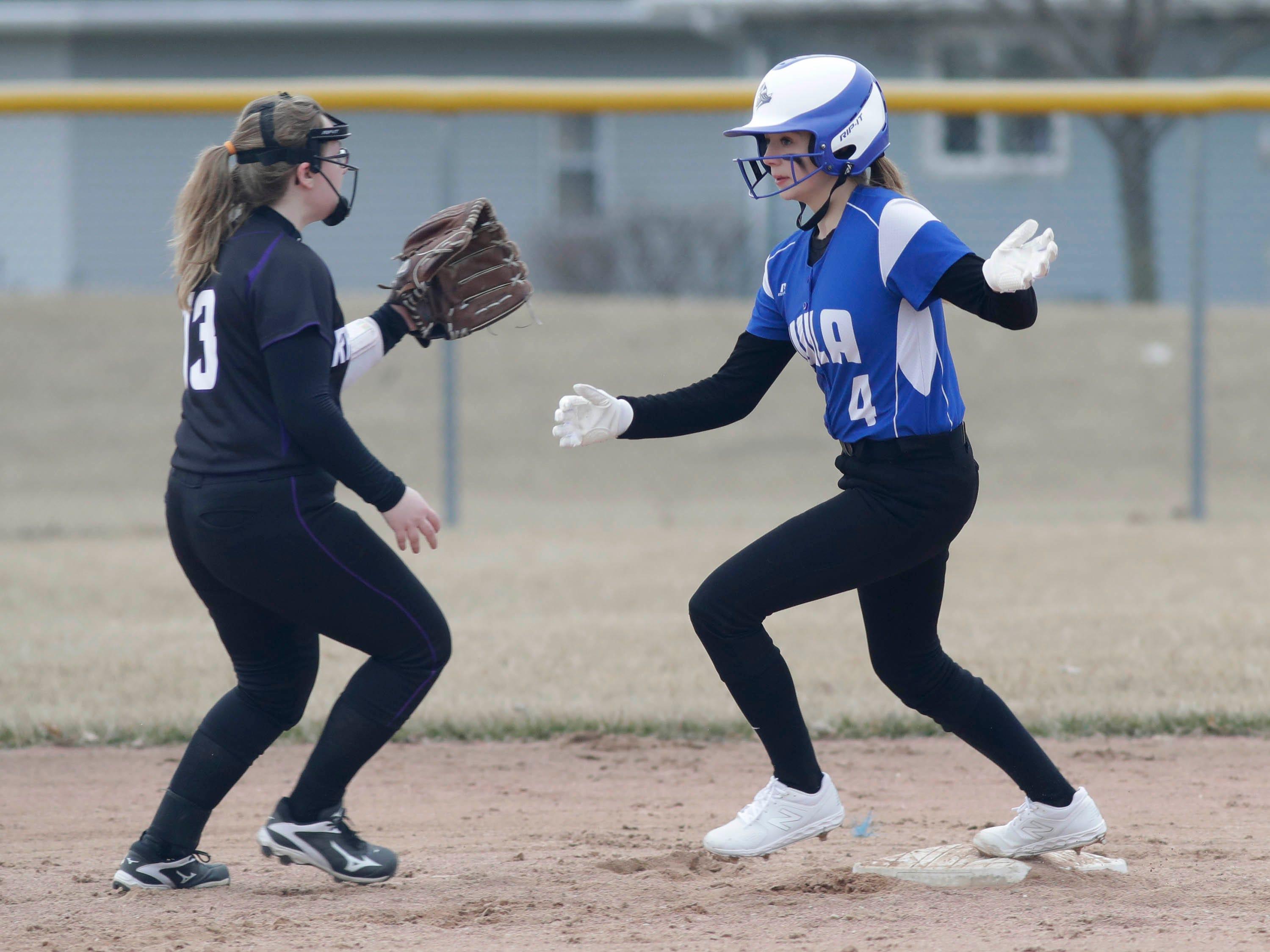 Winnebago Lutheran's Rylee Loehr (4) runs over second base by Kiel's Emily Suchan (13), Thursday, March 28, 2019, in Fond du Lac, Wis.