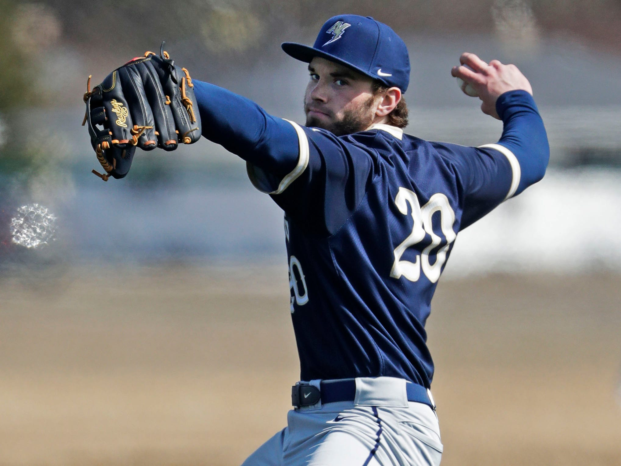 Appleton North's Grant Vervoort (20) winds up a pitch to Sheboygan North, Friday, March 29, 2019, at the Field of Dreams complex in Sheboygan, Wis.
