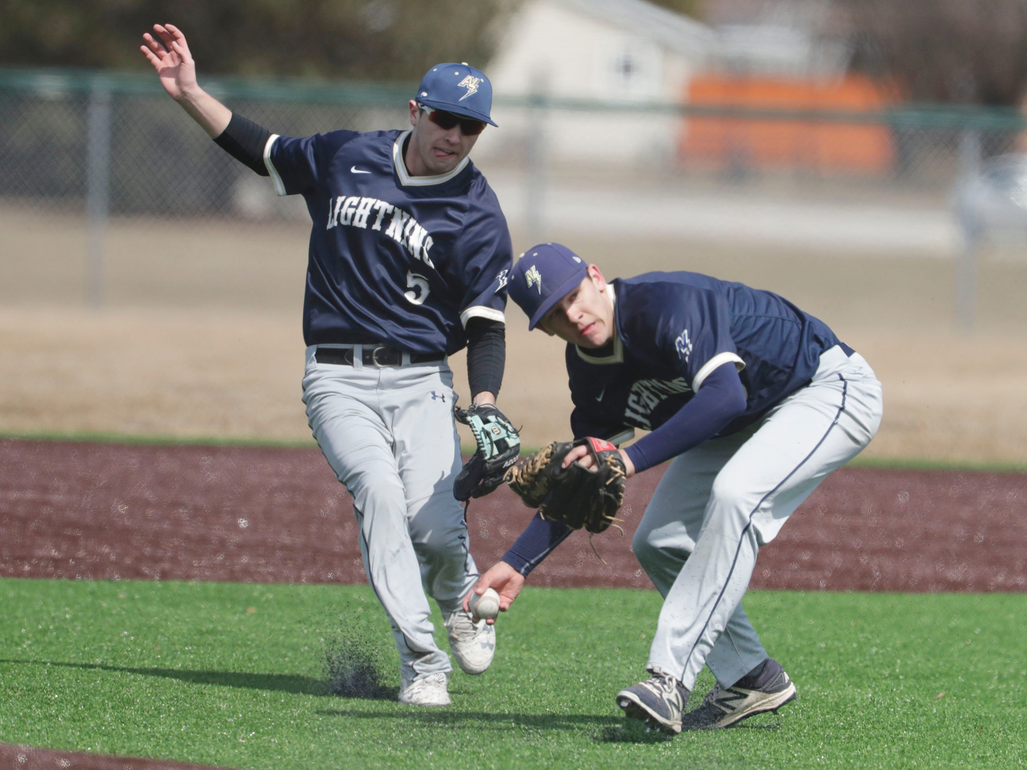 Appleton North's Wilson Zuck (3) backs off as Max Martine (5) fields the ball against Sheboygan North, Friday, March 29, 2019, at the Field of Dreams complex in Sheboygan, Wis.