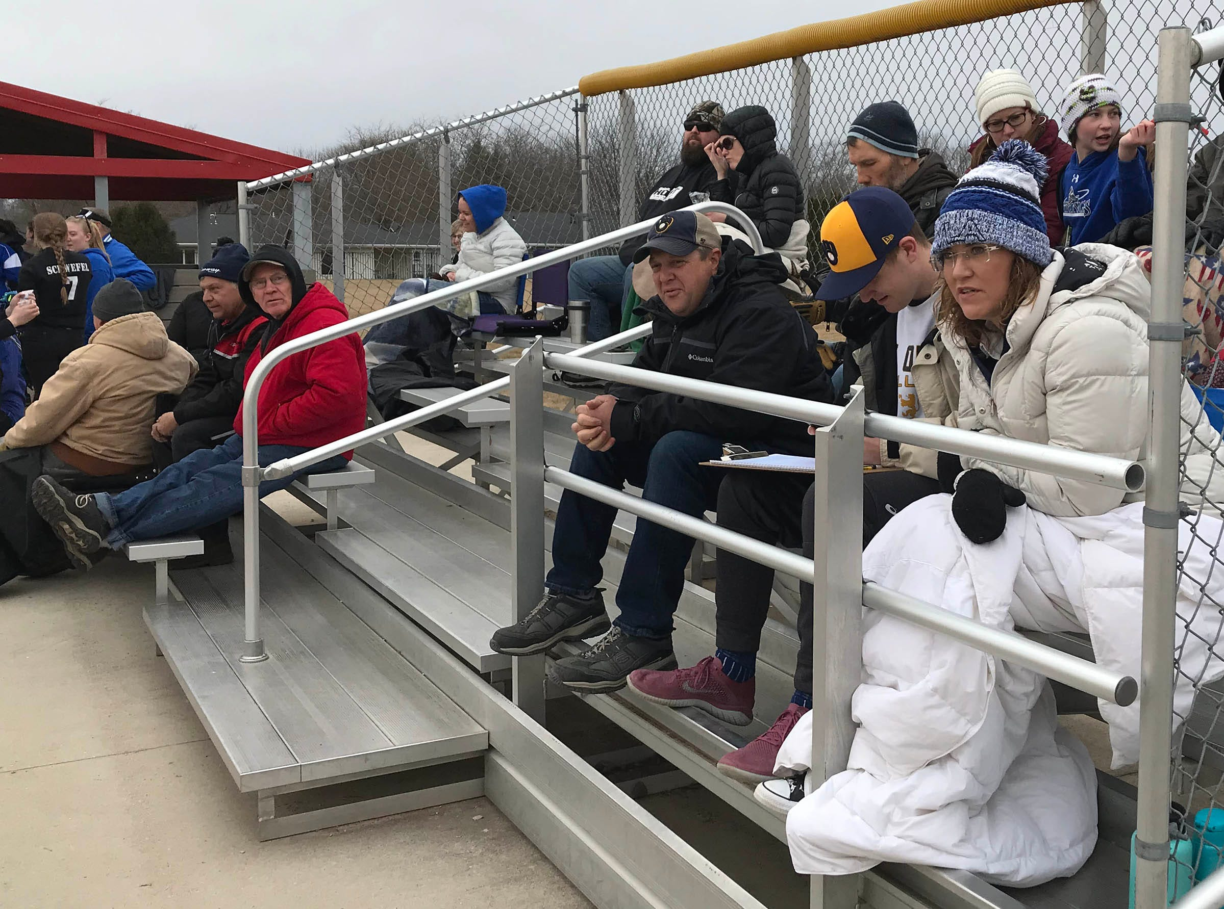 Softball fans were bundled up for spring weather during the game between Winnebago Lutheran and Kiel, Thursday, March 28, 2019, in Fond du Lac, Wis.