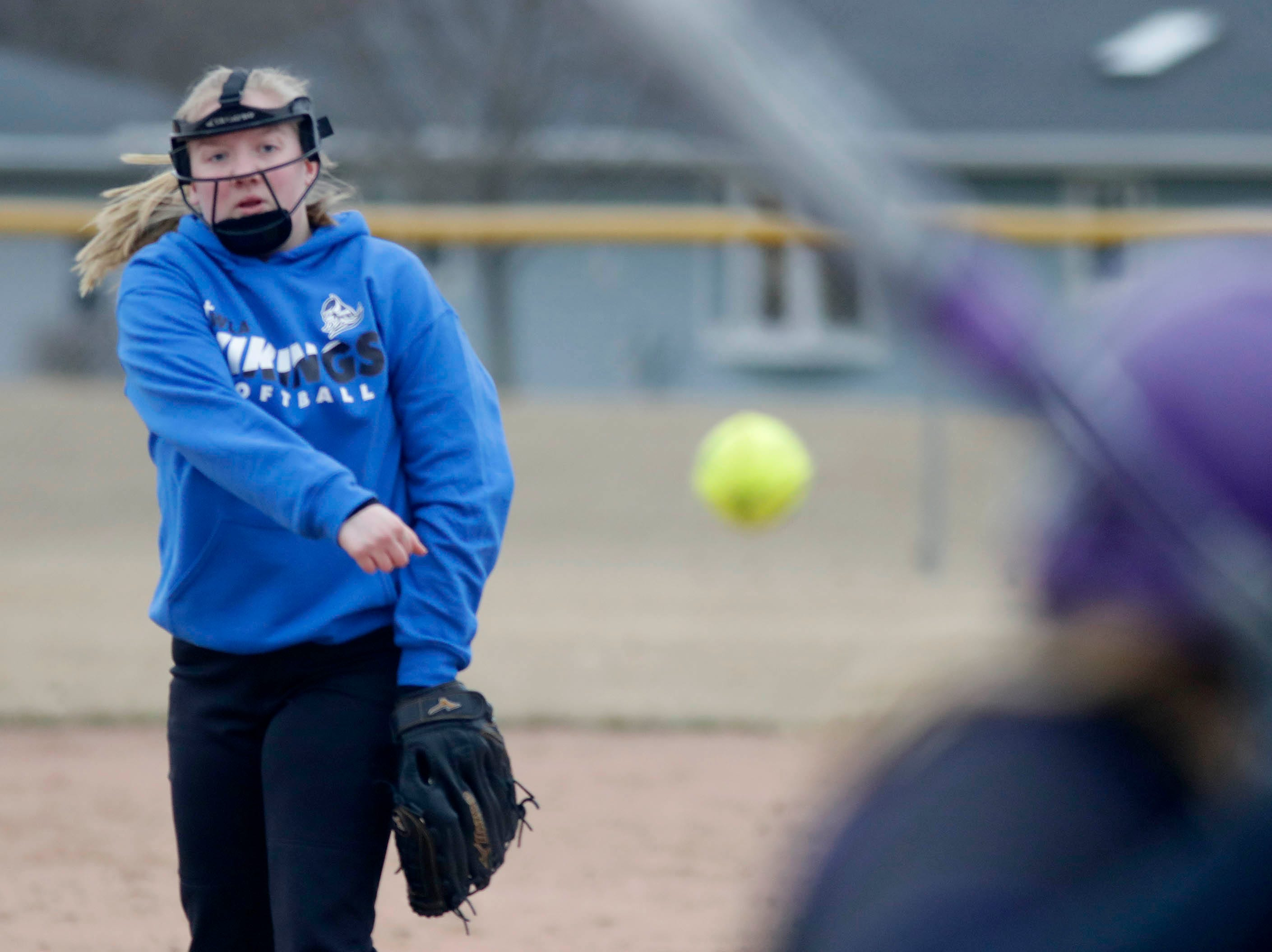 Winnebago Lutheran's Kylie Guell (1) winds up a pitch to a Kiel player at the Youth Baseball Complex, Thursday, March 28, 2019, in Fond du Lac, Wis.