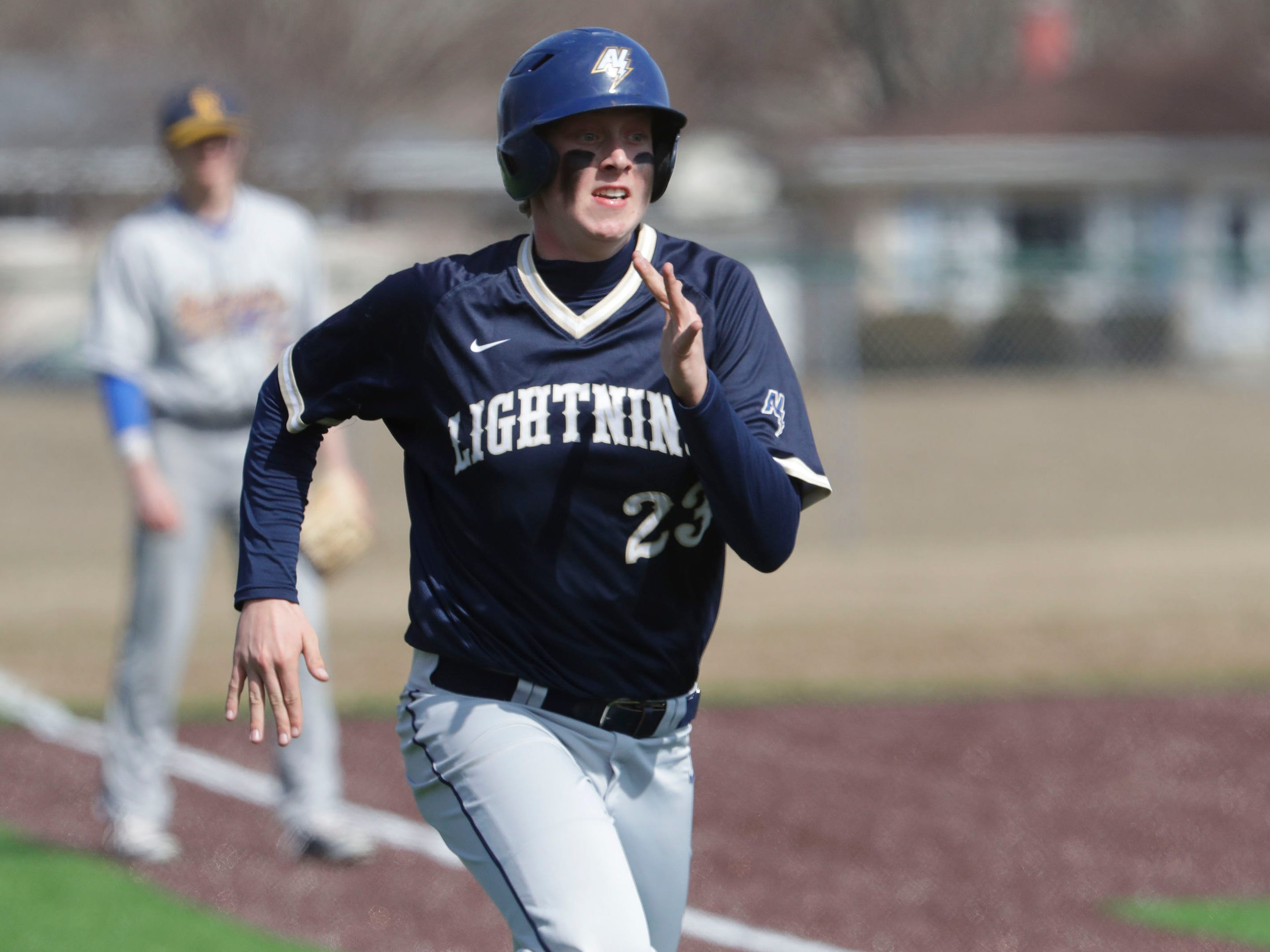 Appleton's Glavin Mathes (23) sprints to home against Sheboygan North, Friday, March 29, 2019, at the Field of Dreams complex in Sheboygan, Wis.