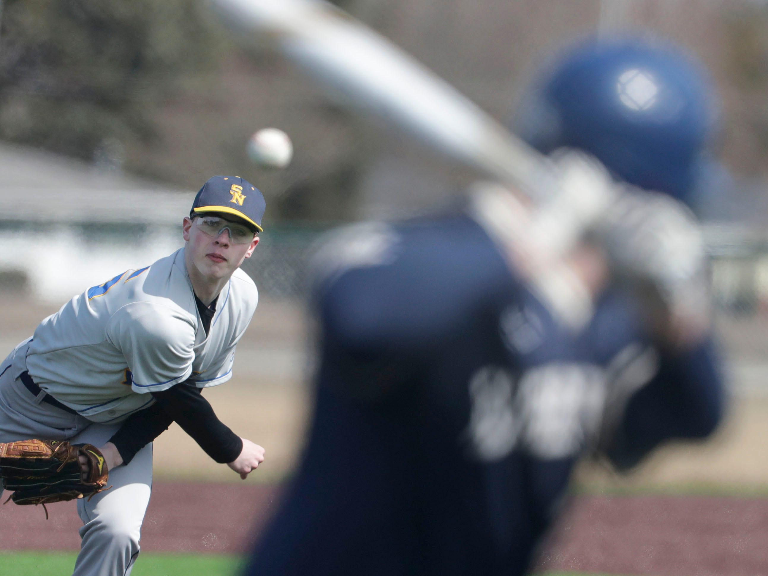 Sheboygan North's Ben Vorphal (25) winds out a photo against Appleton North, Friday, March 29, 2019, at the Field of Dreams complex in Sheboygan, Wis.