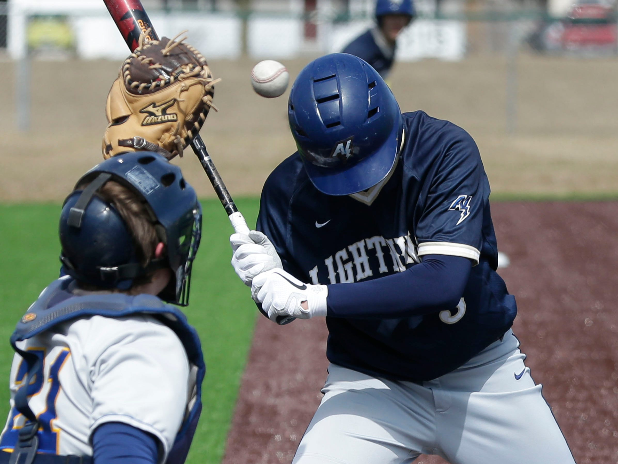 Appleton North's Wilson Zuck (3) evades a close pitch during action with Sheboygan North, Friday, March 29, 2019, at the Field of Dreams complex in Sheboygan, Wis.