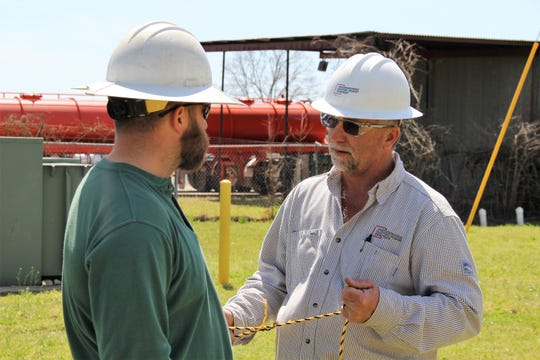 Senior technical training specialist Brad Brown chats with lineman Nik Henry during a training session at SWEPCO's Shreveport Training Center.