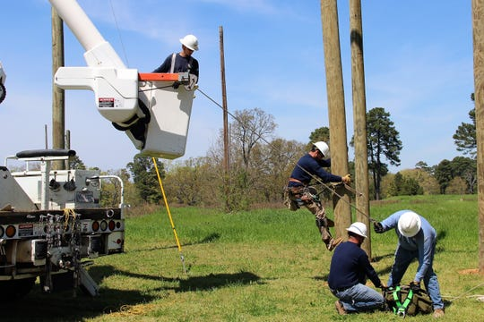A SWEPCO lineman practices climbing a utility pole during a March 27 training exercise at SWEPCO's Shreveport Training Center.