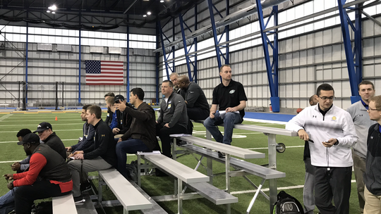 NFL scouts watch players go through the 40-yard dash at Friday's Pro Day in Brookings