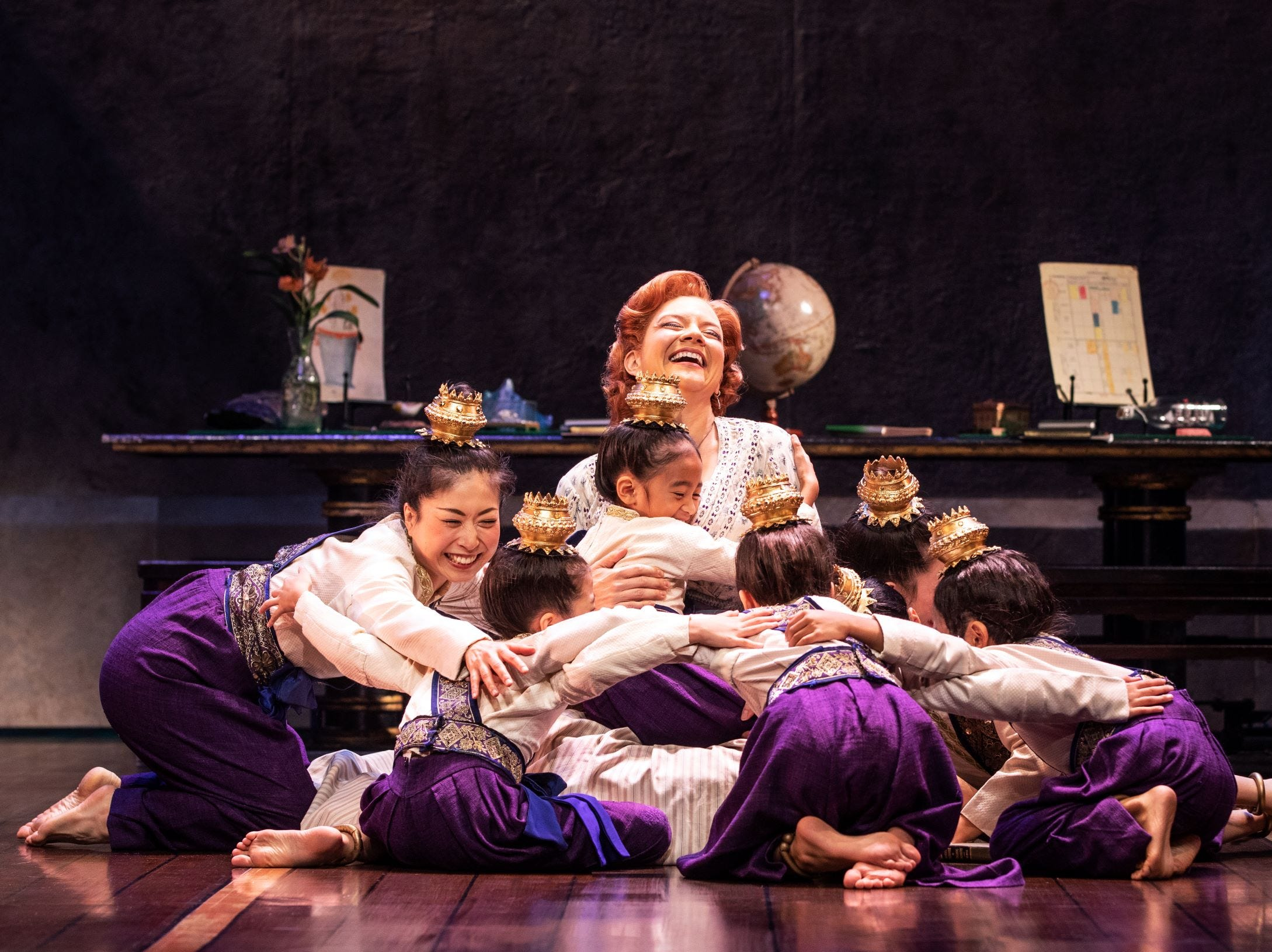 "Angela Baumgardner as Anna Leonowens and the Royal Children in Rodgers & Hammerstein's ""The King and I."""
