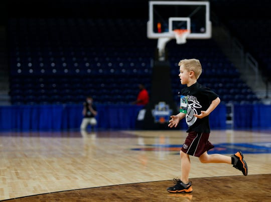 Jackson Harper, 5, the son of Lady Bears head coach Kellie Harper, warms up with the team during a practice session at Wintrust Arena on Friday, March 29, 2019. The Lady Bears are playing Stanford in the NCAA Women's Tournament on Saturday.