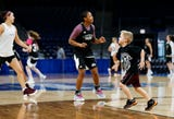 Five-year-old Jackson Harper,  the son of Lady Bears head coach Kellie Harper, has grown up with the team.