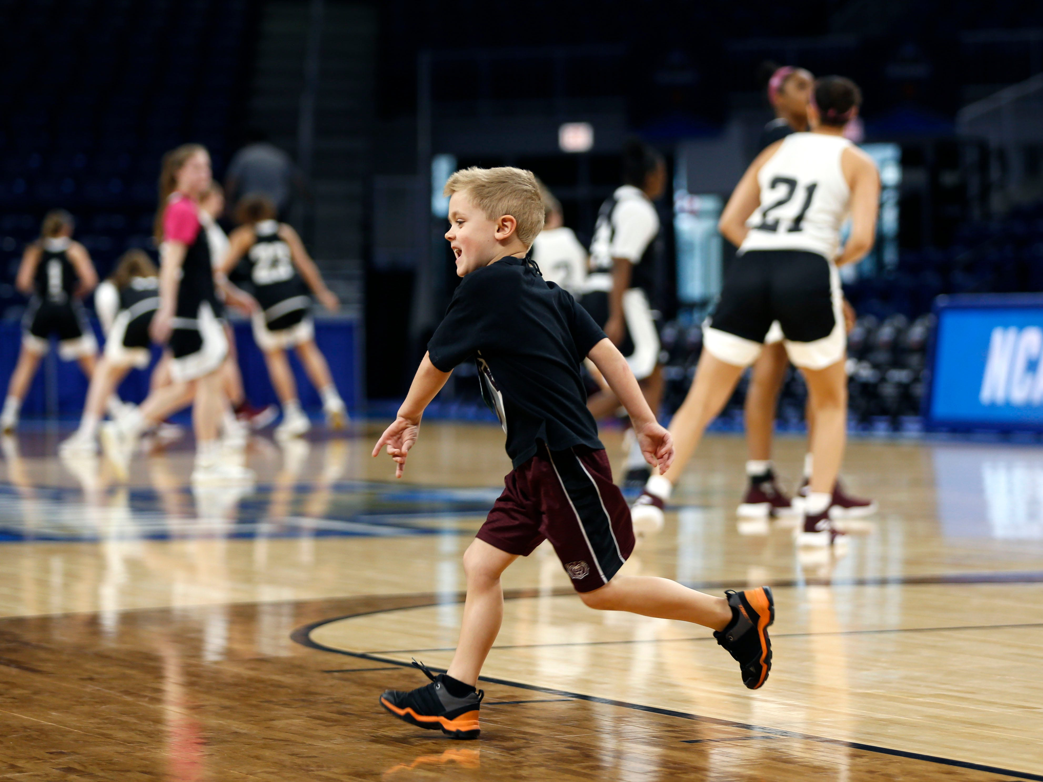 Jackson Harper, 5, the son of Lady Bears head coach Kellie Harper warms up with the team during a practice session at Wintrust Arena on Friday, March 29, 2019. The Lady Bears are playing Stanford in the NCAA Women's Tournament on Saturday.