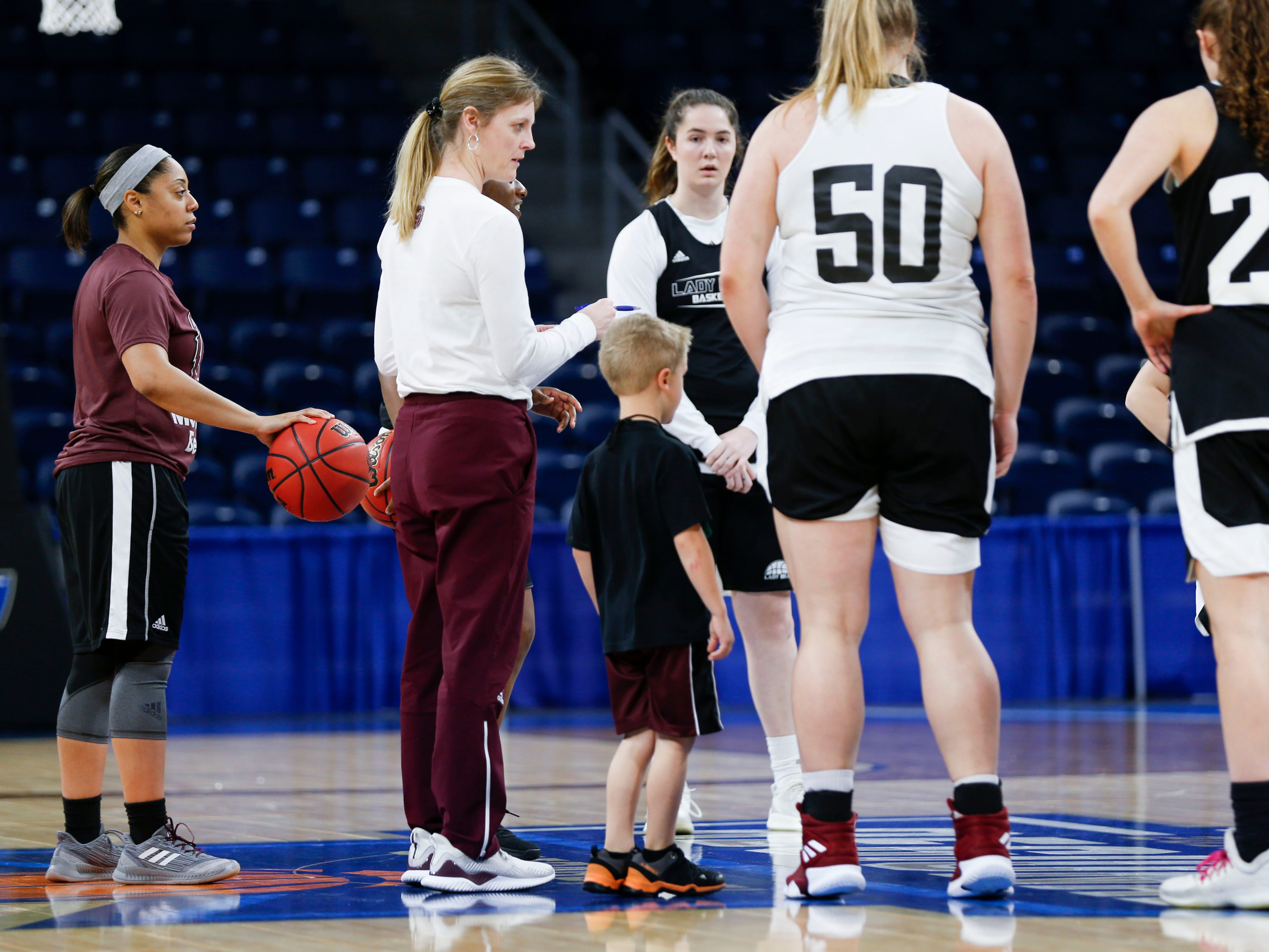 Jackson Harper, 5, the son of Lady Bears head coach Kellie Harper stands with the team during a huddle during a practice session at Wintrust Arena on Friday, March 29, 2019. The Lady Bears are playing Stanford in the NCAA Women's Tournament on Saturday.