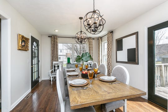 A previous owner used this space as a combination dining room/office, with one chandelier defining the dining space. Lisa added a second chandelier to extend the space to accommodate a larger dining table.