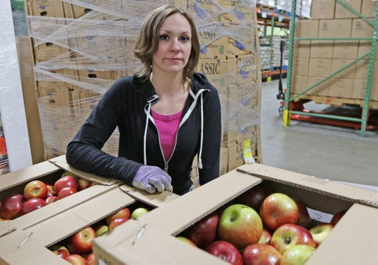 Tiffany Woodward works at the Blue Ridge Area Food Bank warehouse in Verona through the work release program at Middle River Regional Jail on Friday, March 29, 2019.