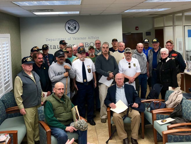 A group of local Vietnam veterans poses for a group photo at the Staunton Community Based Outpatient Clinic on March 29. 2019.
