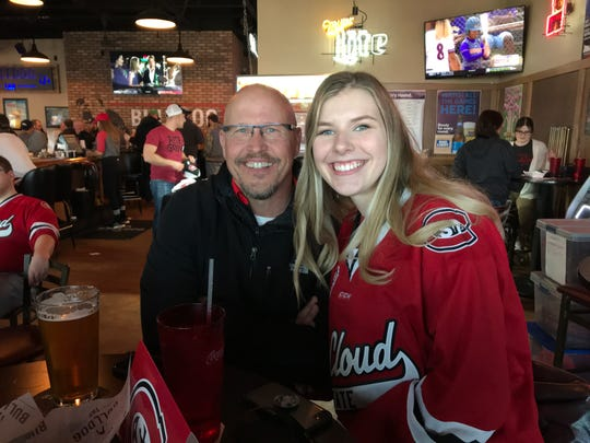 Coming to cheer on the St. Cloud State men's hockey team are Doug Thielen (left) and his daughter, McKenna Thielen. The two live in Maple Grove.