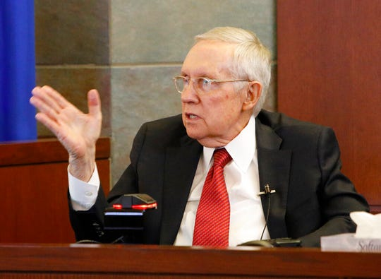Former U.S. Sen. Harry Reid speaks from the witness stand, Thursday, March 28, 2019, in Las Vegas. Reid testified in his negligence lawsuit against the maker of an exercise device. (AP Photo/John Locher)