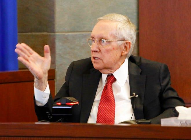 Former U.S. Sen. Harry Reid speaks from the witness stand, Thursday, March 28, 2019, in Las Vegas. Reid testified in his negligence lawsuit against the maker of an exercise device. (AP Photo/John Locher)