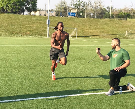 Former FAMU defensive back Jalen Douse runs the 40-yard dash on Thursday, March 28, 2019. Strength and conditioning coach Parker Brooks times him in the event.