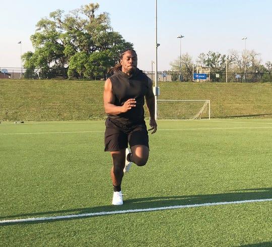 Former FAMU linebacker Jibreel Hazly runs a 40-yard dash on Thursday, March 28, 2019.