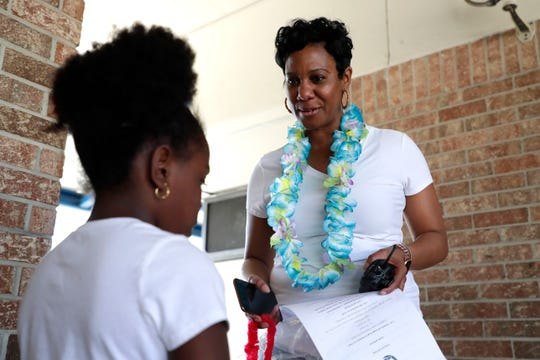 "Oak Ridge Elementary principal Jasmine Smith talks with a student before an FSA testing pep rally Friday, March 29, 2019. During the ""Swag and Surf"" rally, students sang and danced. Teachers and coaches emphasized students needed to focus and work hard on the tests."