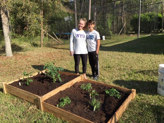 Candace's grandchildren and the garden planted for their mom.