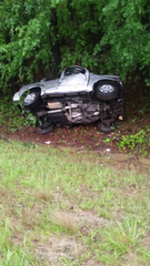The SUV flipped several times before slamming into a tree. Its driver was using a phone.