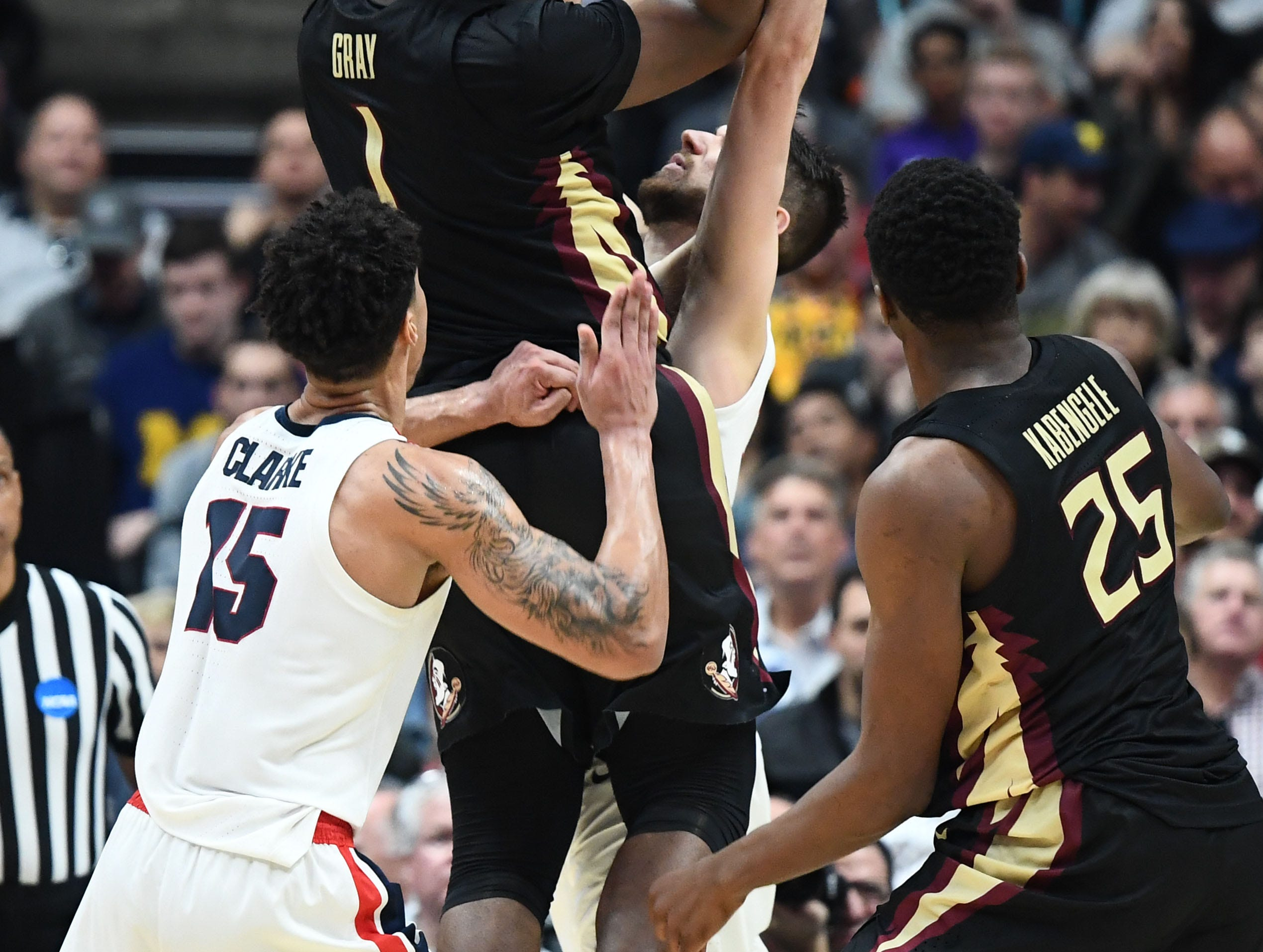 March 28, 2019; Anaheim, CA, USA; Florida State Seminoles forward Raiquan Gray (1) shoots ahead of Gonzaga Bulldogs forward Brandon Clarke (15) during the second half in the semifinals of the west regional of the 2019 NCAA Tournament at Honda Center. Mandatory Credit: Robert Hanashiro-USA TODAY Sports