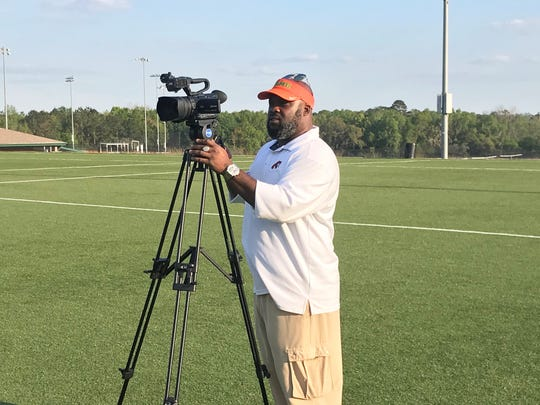 FAMU videographer Jacob Henderson recorded footage of players during their 40-yard runs.