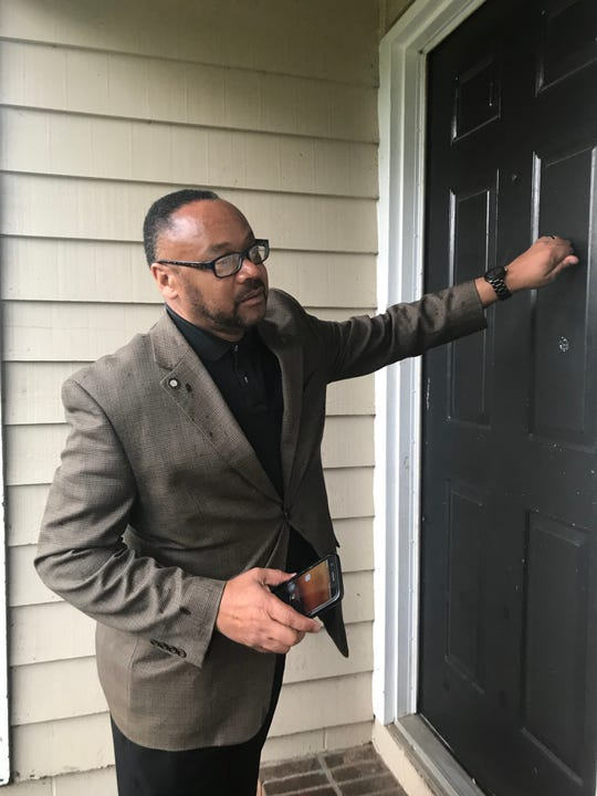 Kimbal Thomas, who runs the city's TEMPO program targeting youth who are out of work and unemployed, knocks on the door of 18-year-old Daniel Anderson. Thomas is working to make inroads in communities where crime and its root causes are an issue.