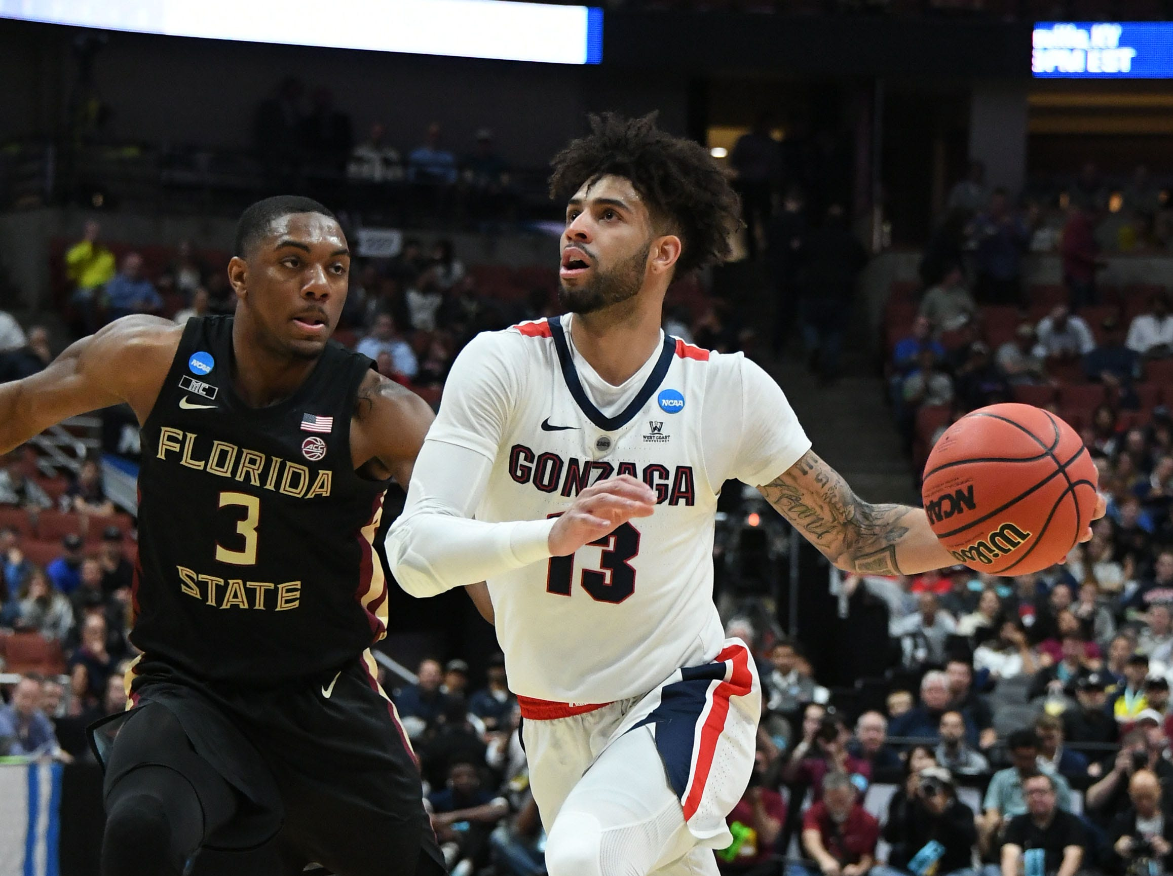 March 28, 2019; Anaheim, CA, USA; Gonzaga Bulldogs guard Josh Perkins (13) moves to the basket against Florida State Seminoles guard Trent Forrest (3) during the first half in the semifinals of the west regional of the 2019 NCAA Tournament at Honda Center. Mandatory Credit: Richard Mackson-USA TODAY Sports