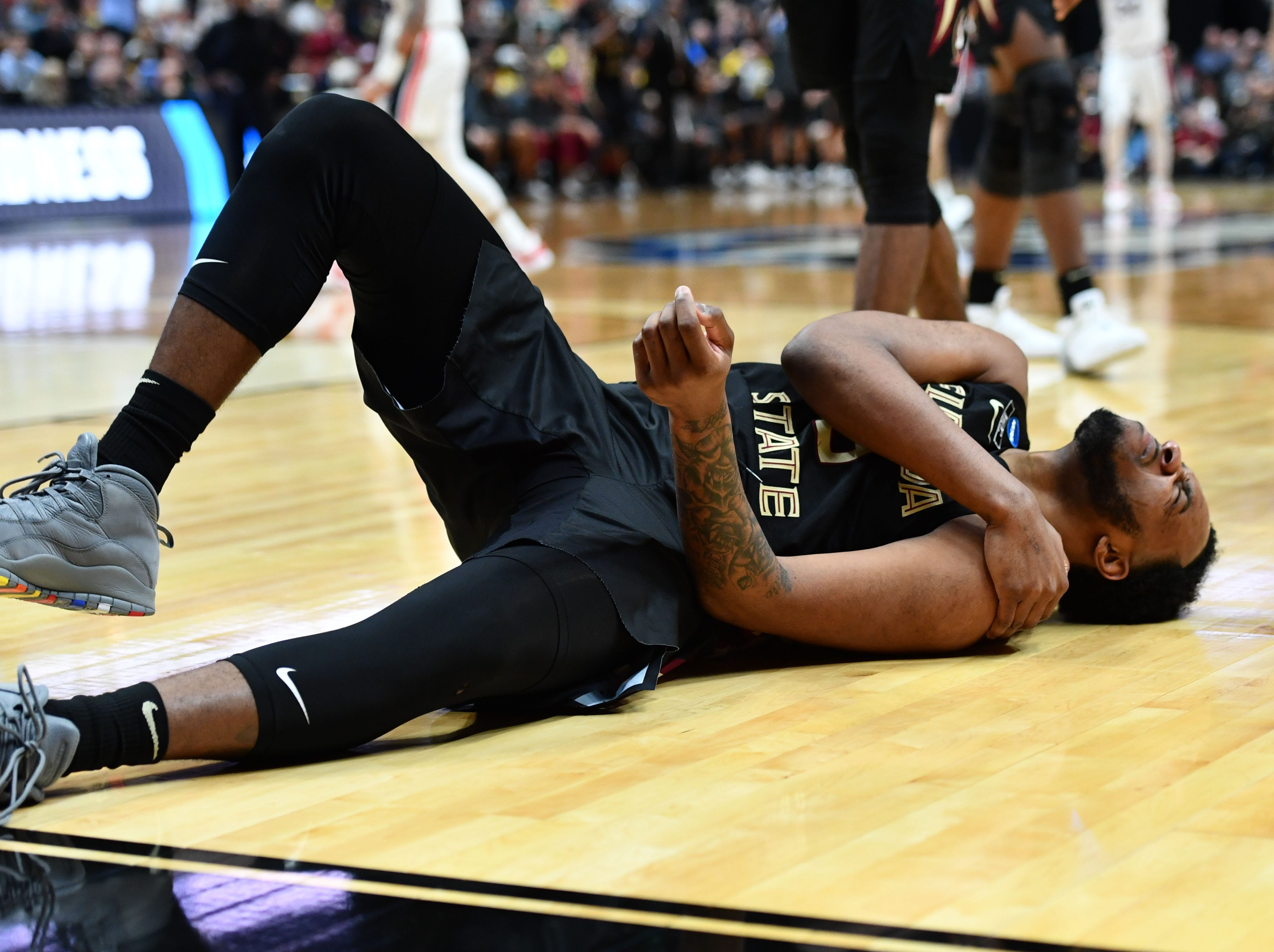 March 28, 2019; Anaheim, CA, USA; Florida State Seminoles guard PJ Savoy (5) reacts after falling against the Gonzaga Bulldogs during the second half in the semifinals of the west regional of the 2019 NCAA Tournament at Honda Center. Mandatory Credit: Robert Hanashiro-USA TODAY Sports