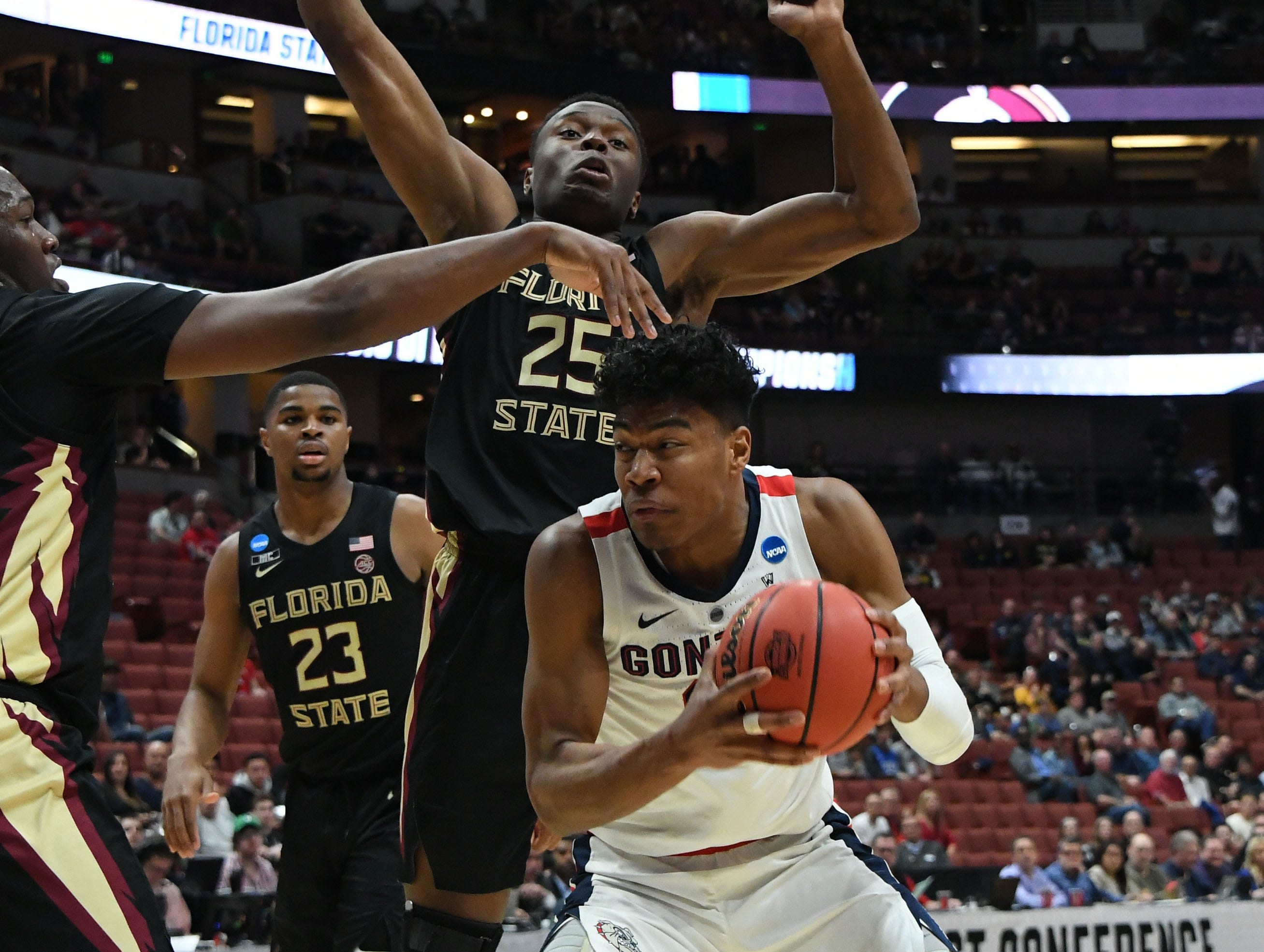 March 28, 2019; Anaheim, CA, USA; Gonzaga Bulldogs forward Rui Hachimura (21) moves the ball against Florida State Seminoles forward Mfiondu Kabengele (25) and guard M.J. Walker (23) during the first half in the semifinals of the west regional of the 2019 NCAA Tournament at Honda Center. Mandatory Credit: Richard Mackson-USA TODAY Sports