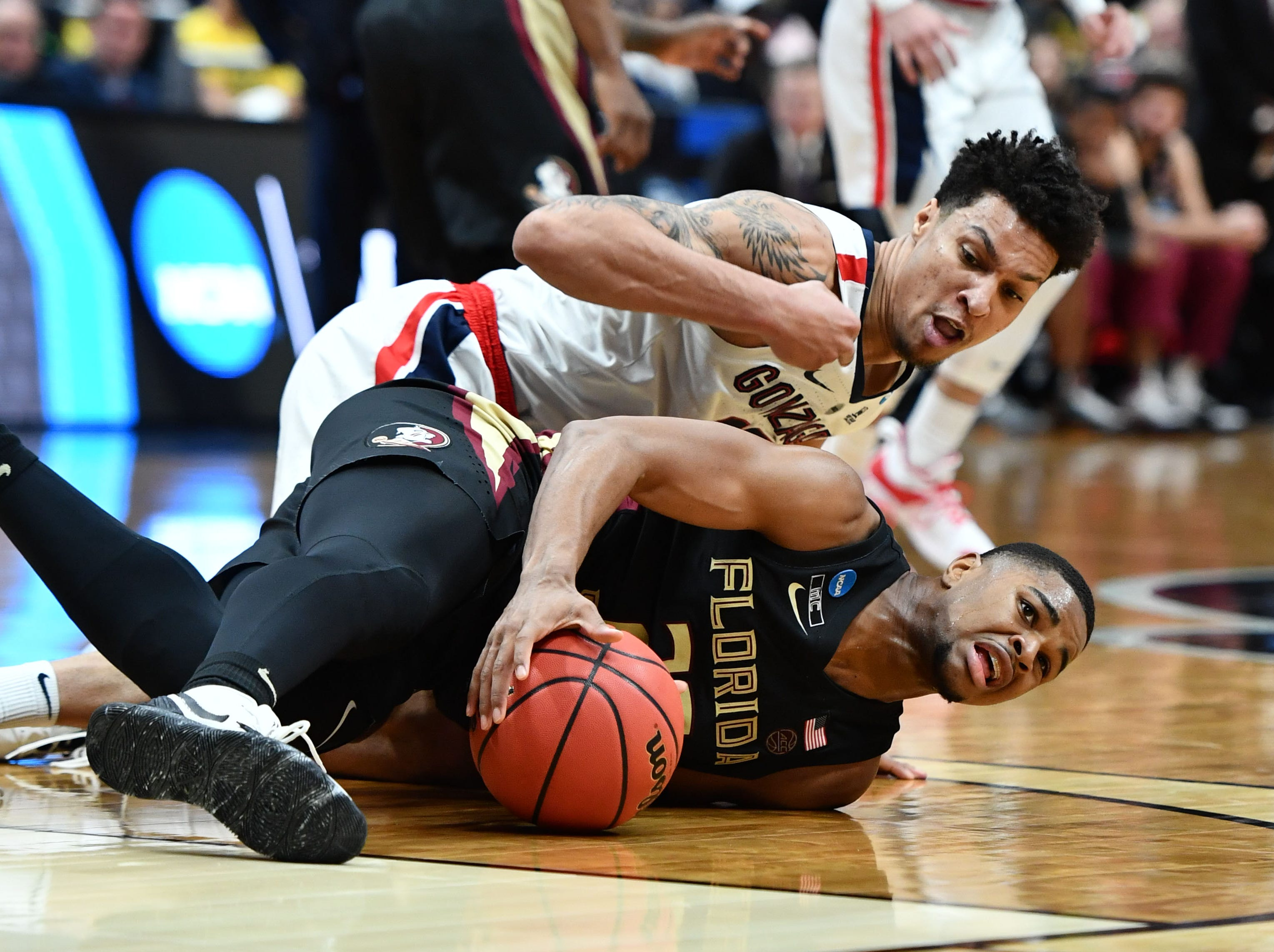 March 28, 2019; Anaheim, CA, USA; Florida State Seminoles guard M.J. Walker (23) keeps the ball away from Gonzaga Bulldogs forward Brandon Clarke (15) during the second half in the semifinals of the west regional of the 2019 NCAA Tournament at Honda Center. Mandatory Credit: Robert Hanashiro-USA TODAY Sports
