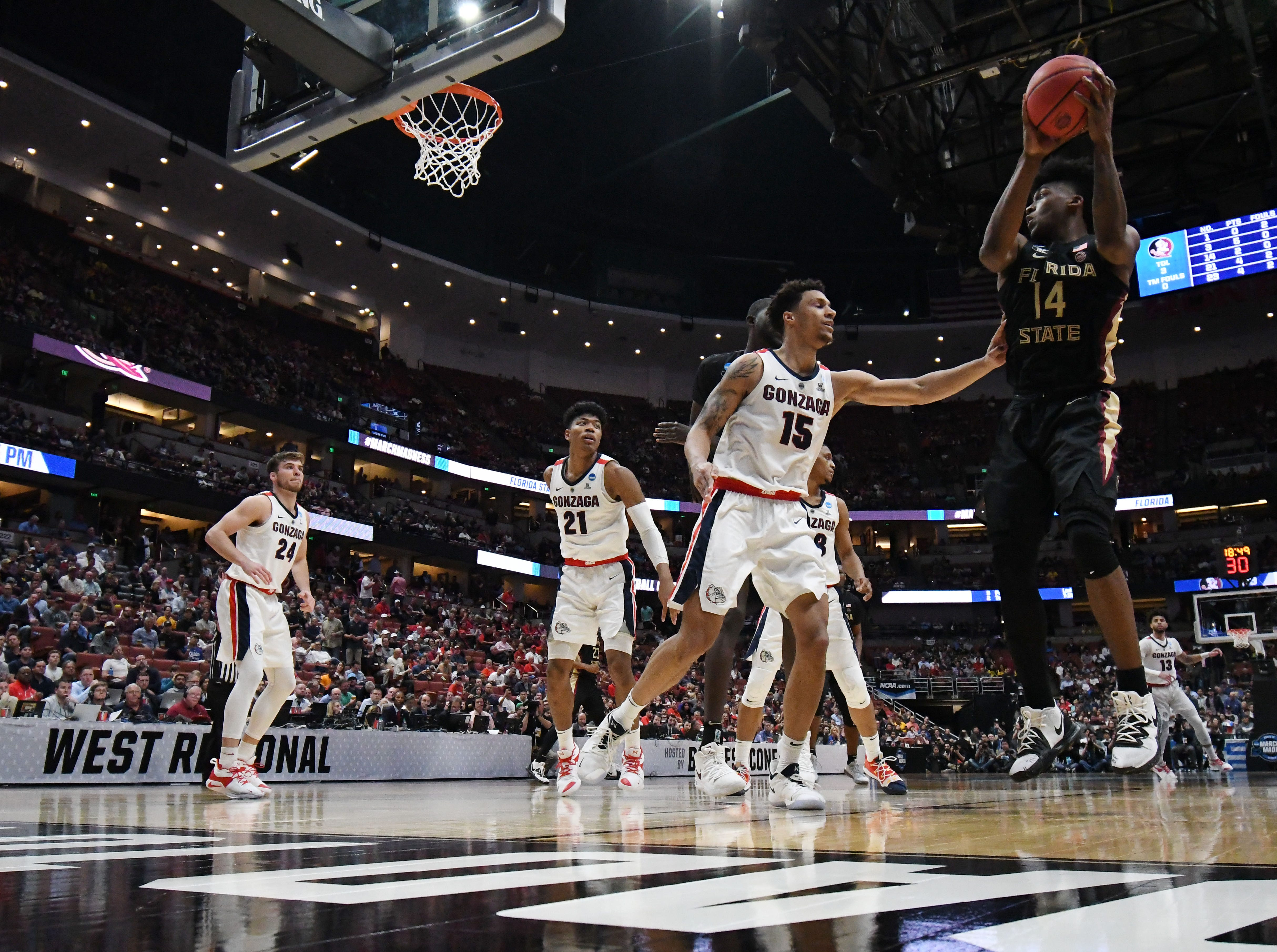 March 28, 2019; Anaheim, CA, USA; Florida State Seminoles forward Raiquan Gray (1)4 controls the ball against Gonzaga Bulldogs forward Brandon Clarke (15) during the second half in the semifinals of the west regional of the 2019 NCAA Tournament at Honda Center. Mandatory Credit: Richard Mackson-USA TODAY Sports