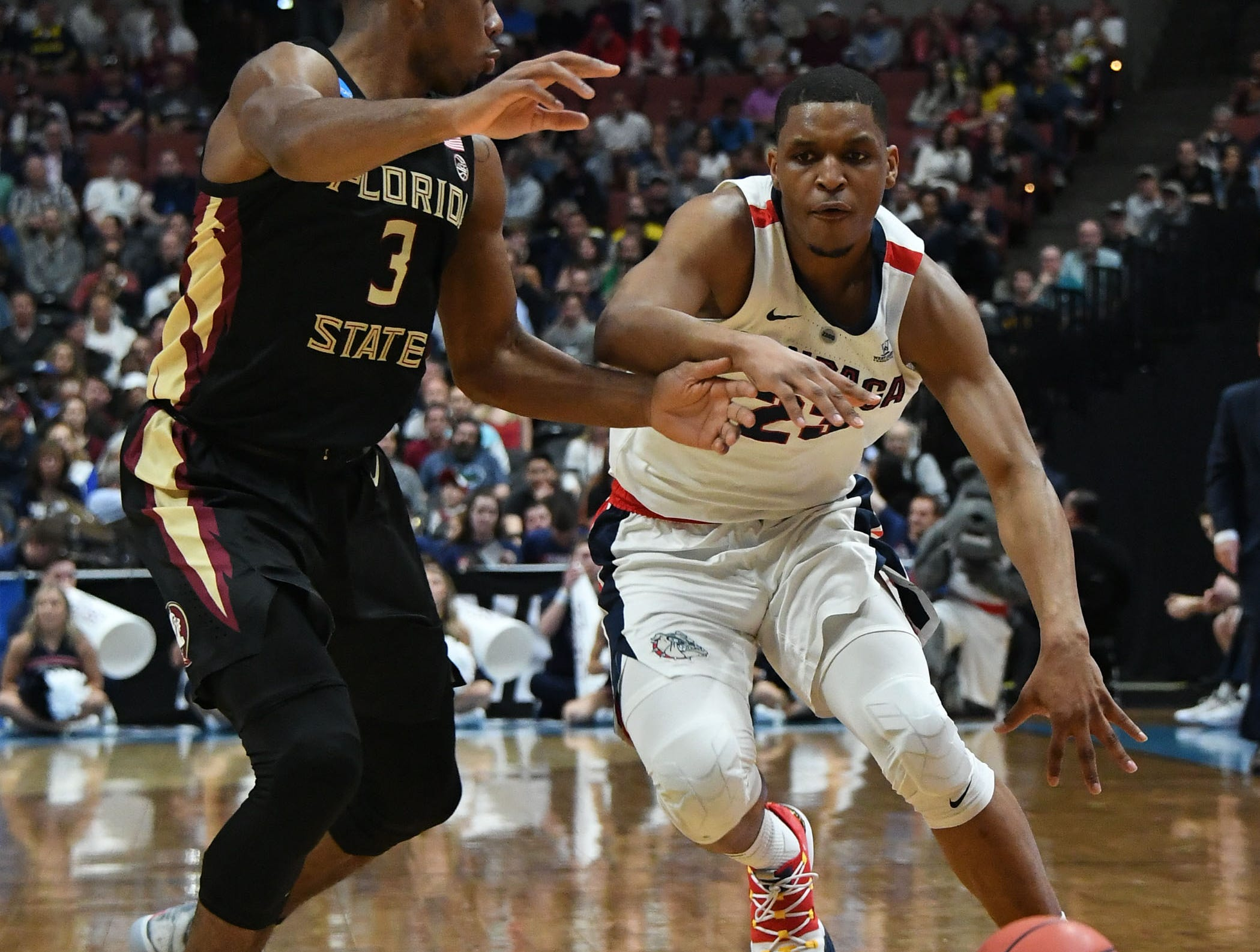 March 28, 2019; Anaheim, CA, USA; Gonzaga Bulldogs guard Zach Norvell Jr. (23) moves the ball against Florida State Seminoles guard Trent Forrest (3) during the first half in the semifinals of the west regional of the 2019 NCAA Tournament at Honda Center. Mandatory Credit: Richard Mackson-USA TODAY Sports