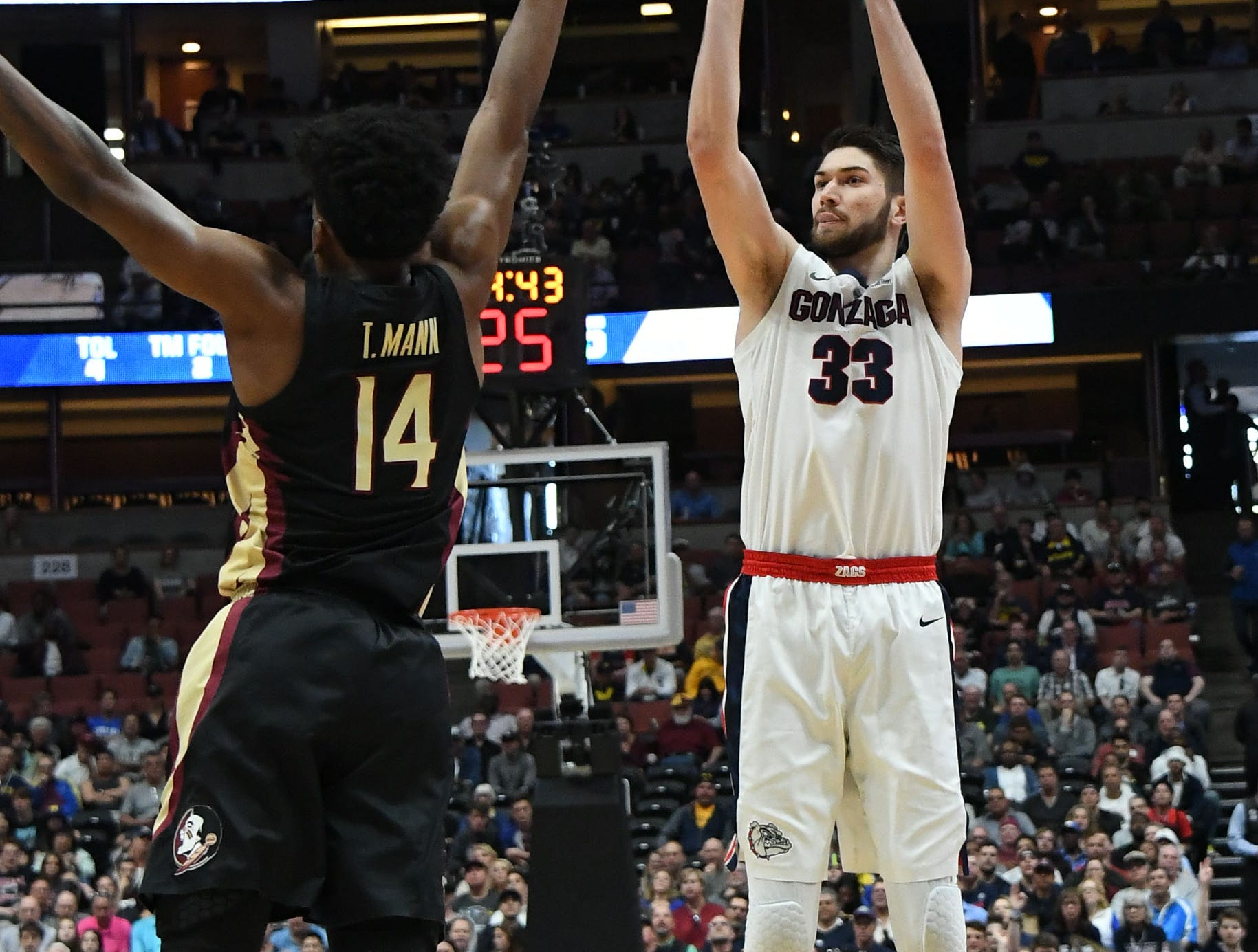 March 28, 2019; Anaheim, CA, USA; Gonzaga Bulldogs forward Killian Tillie (33) shoots against Florida State Seminoles guard Terance Mann (14) during the first half in the semifinals of the west regional of the 2019 NCAA Tournament at Honda Center. Mandatory Credit: Richard Mackson-USA TODAY Sports