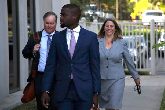 Former Downtown Improvement Authority Executive Director Paige Carter-Smith walks up to the U.S. District Courthouse in downtown Tallahassee with her lawyers for a case management conference Friday, March 29, 2019.